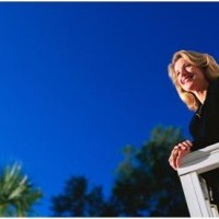 woman on deck with blue sky above