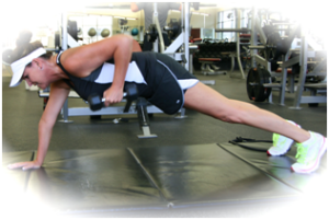 52-year old Michelle doing a row from plank position