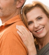 attractive mature woman leaning on husband
